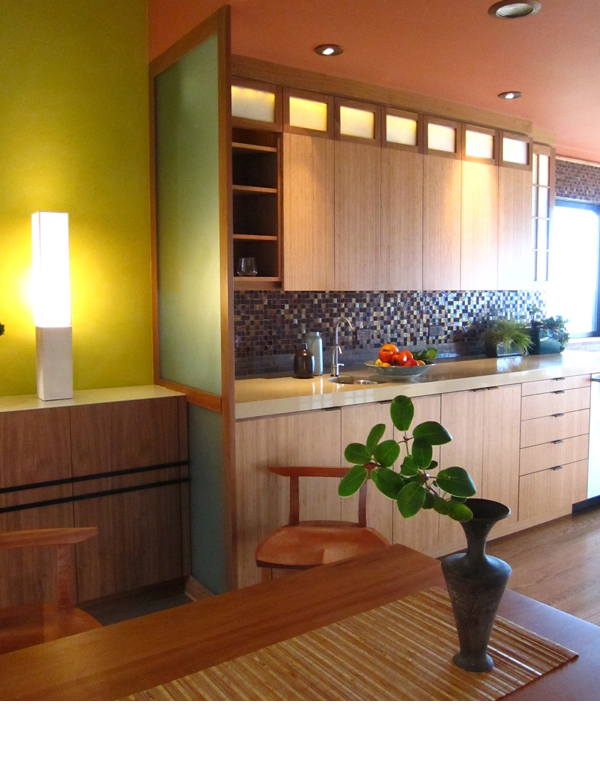 Modern bamboo cabinets with accents of walnut trim and mahogany furnishings contributed to this Japanese inspired kitchen
