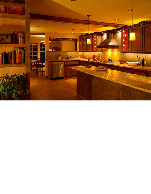 The openness of the kitchen allows for the family room to be part of the kitchen, and preparing food, a central activity.