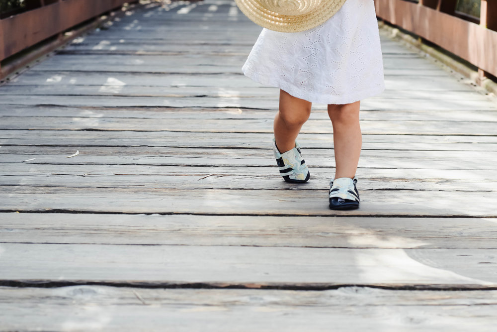 Kinbe - Moccasins That Grow With Your Baby's Feet - Socially Conscious Kids Fashion - Kinbe Village Drive