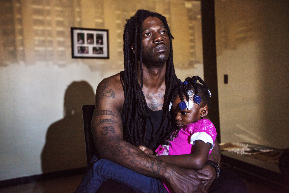 "Raheem Grant, 39, poses for a portrait with his daughter, Nature Grant. ""When I was growing up I didn' t have a father. My little one, she gets scared of the dark: ' You don' t have to be scared because Daddy is here.' Just knowing that I am there for them makes me feel like I accomplished a lot."