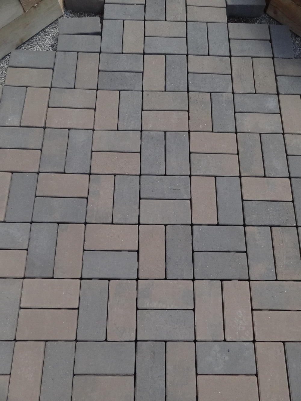 new permeable pavers (made from recycled fly-ash)
