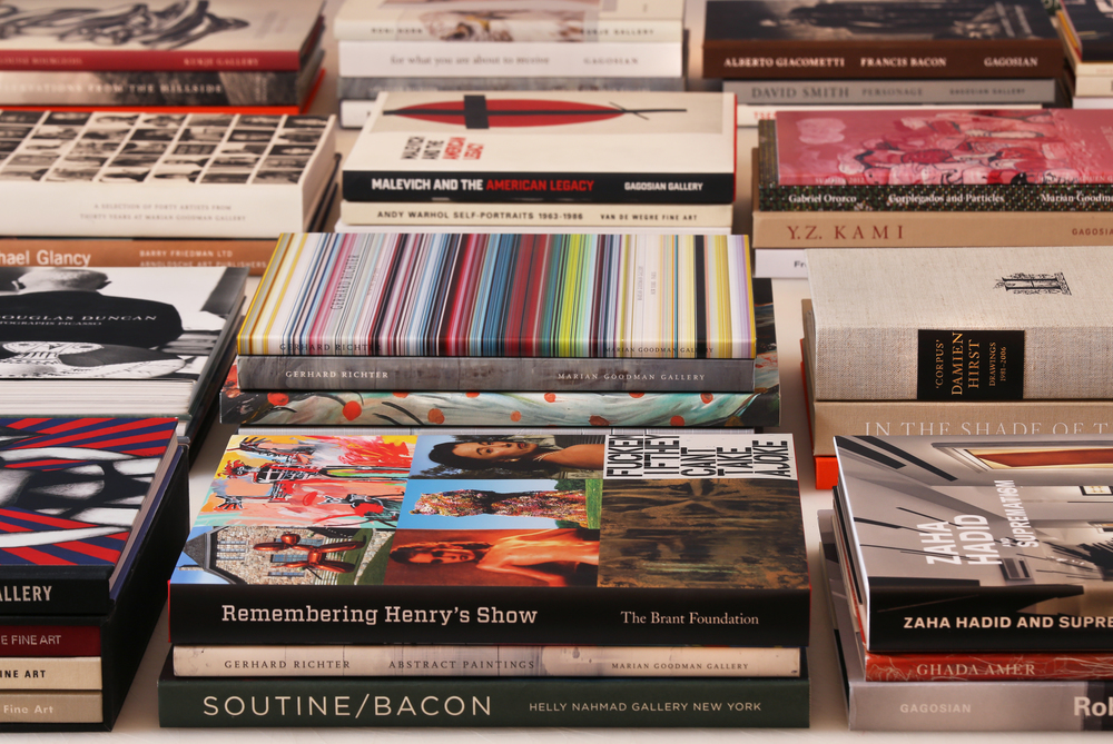 Collection of art publications designed by Dan Miller Design