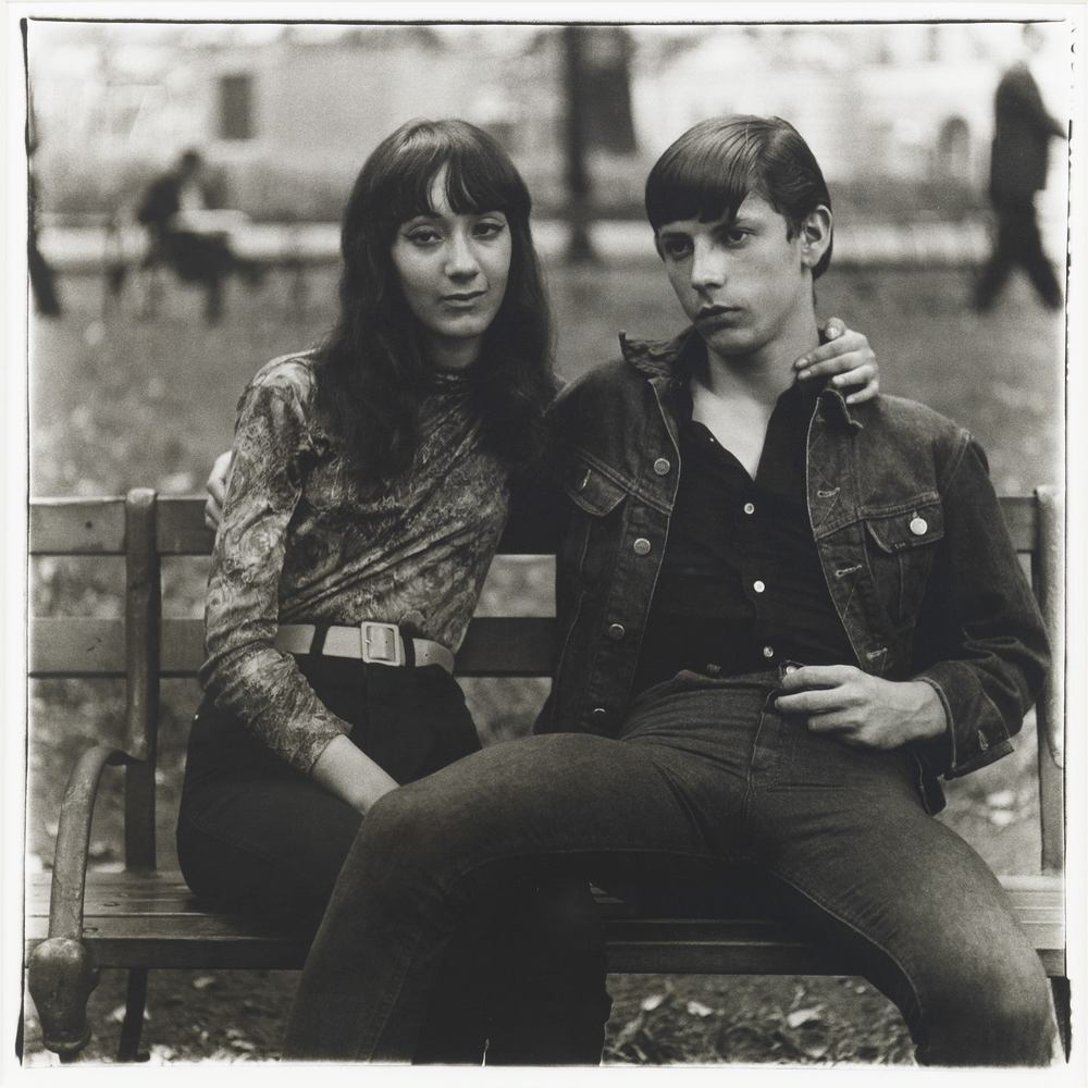 Diane Arbus (1923 - 1971) Young couple on a bench in Washington Square Park, N.Y.C. 1965 Gelatin silver print 14 3/8 x 15 1/2 inches 36.5 x 39.4 centimeters The Estate of Diane Arbus, LLC CR# AR.36763