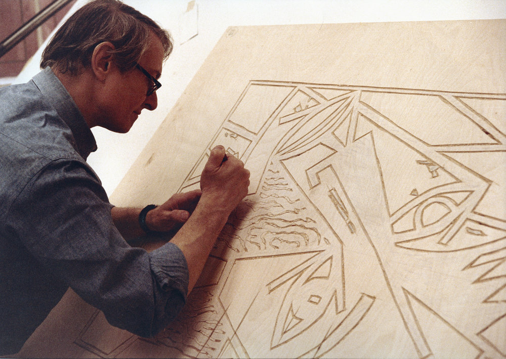 "Roy Lichtenstein carving into a wood block for ""Head,"" 1980, © Photograph by Sidney B. Felsen"