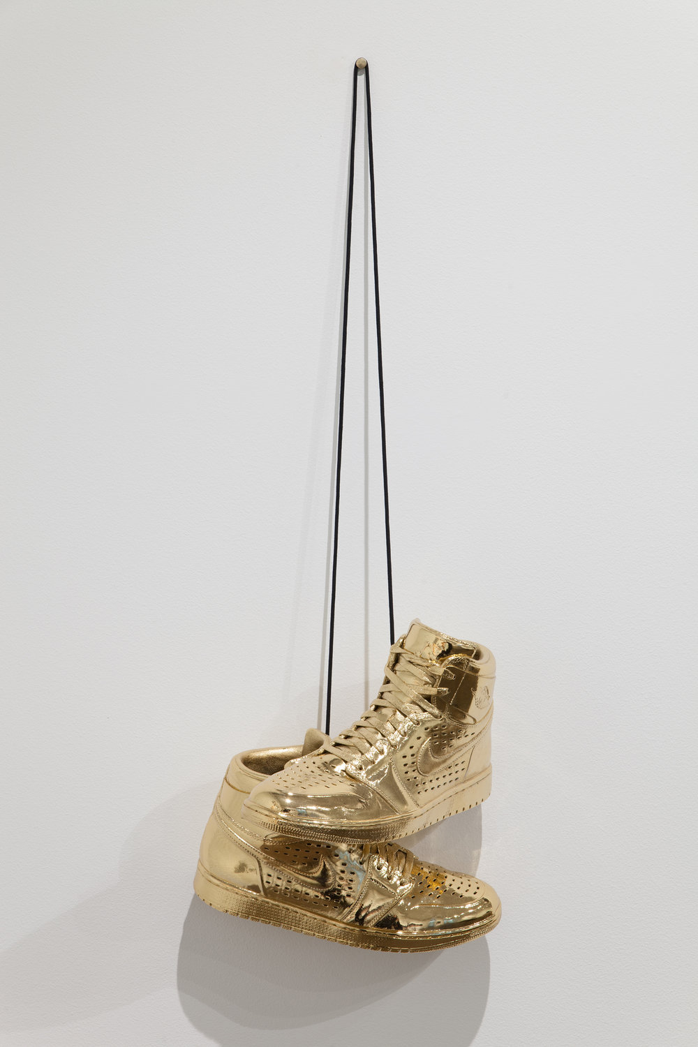 Kendell Carter,  Effigy for a New Normalcy VII , 2017. 14k gold plated, bronzed Air Jordans. Photo courtesy of Michael DeFilippo. From upcoming exhibition   RESPECT:   Hip-Hop Style & Wisdom .