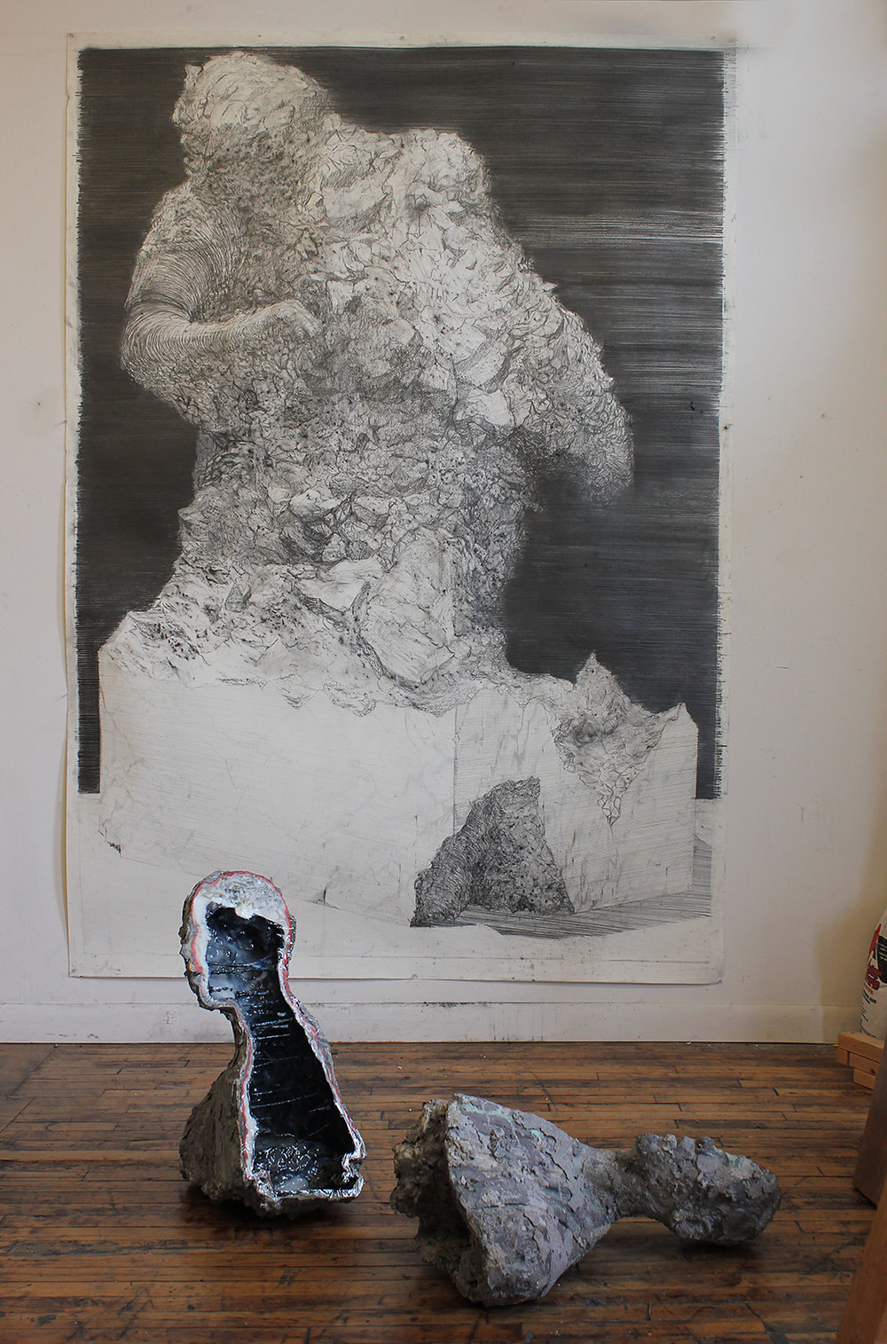 Top:  Unfinished Monument II , 2018, graphite on paper, 58 x 98 inches. Bottom:  Geode (Michael Jordan),  gypsum, resin, metal powder, pigment.