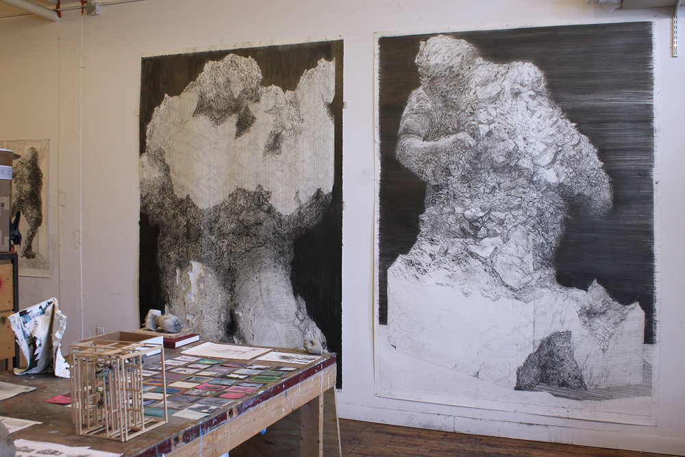Left:  Unfinished Monument I,  2018, graphite on paper, 58 x 98 inches. Right:  Unfinished Monument II , 2018, graphite on paper, 58 x 97 inches.