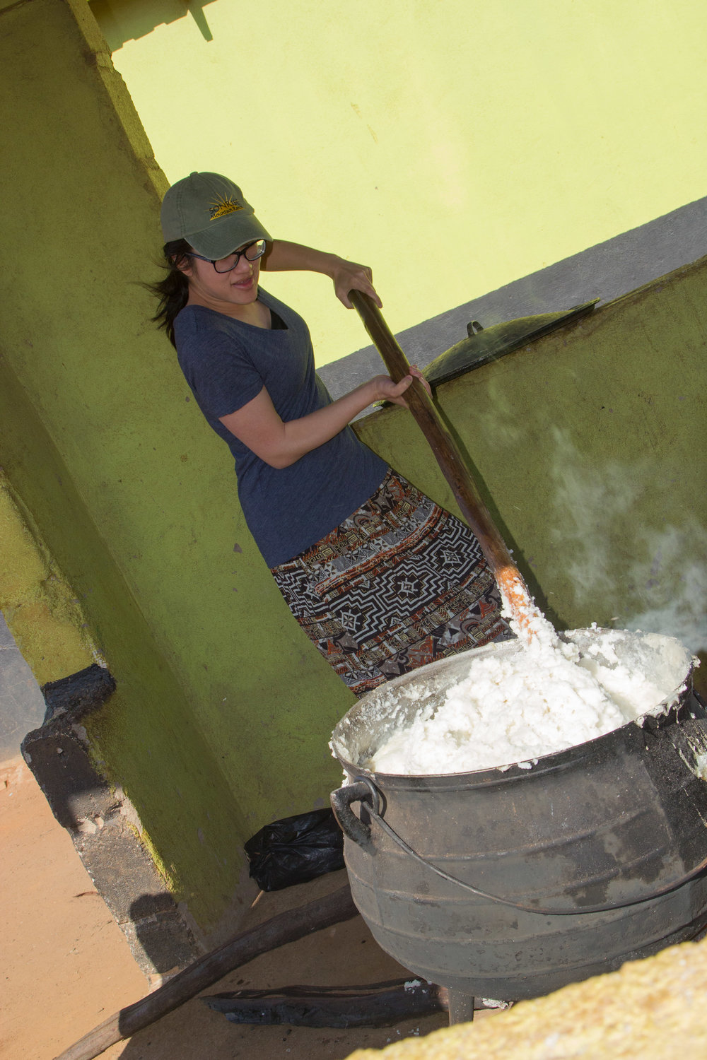 Anna trying to stir the maize meal