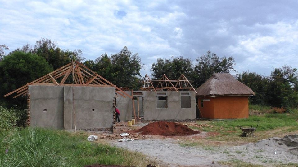 Three classrooms being constructed next to the Andrea Vogt Roadside Stand.