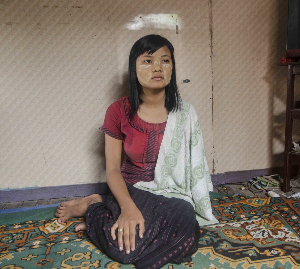 (MANDALAY) Zin Mar Htwe was 14 years old when she lost her hand in a hydraulic press at the Shin Yet steel factory. She is now an honorary members of the Cooperative Committee of Trade Unions (CCTU), a labour rights organization that advocates for factory workers who are injured on the job. [ Charles Michio Turner/ Al Jazeera]