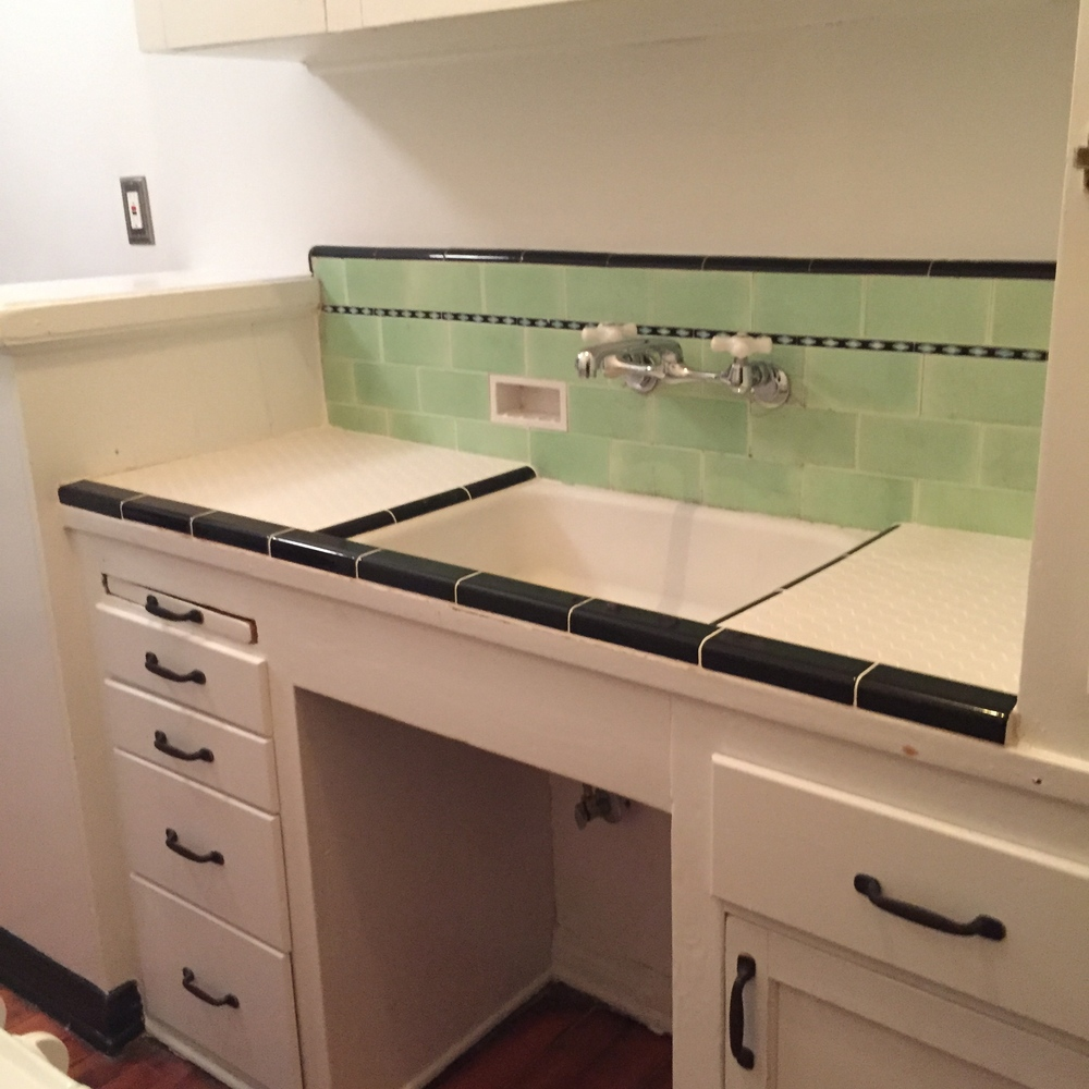 1932 kitchen restored and updated to preserve the period feel without sacrificing functionality.