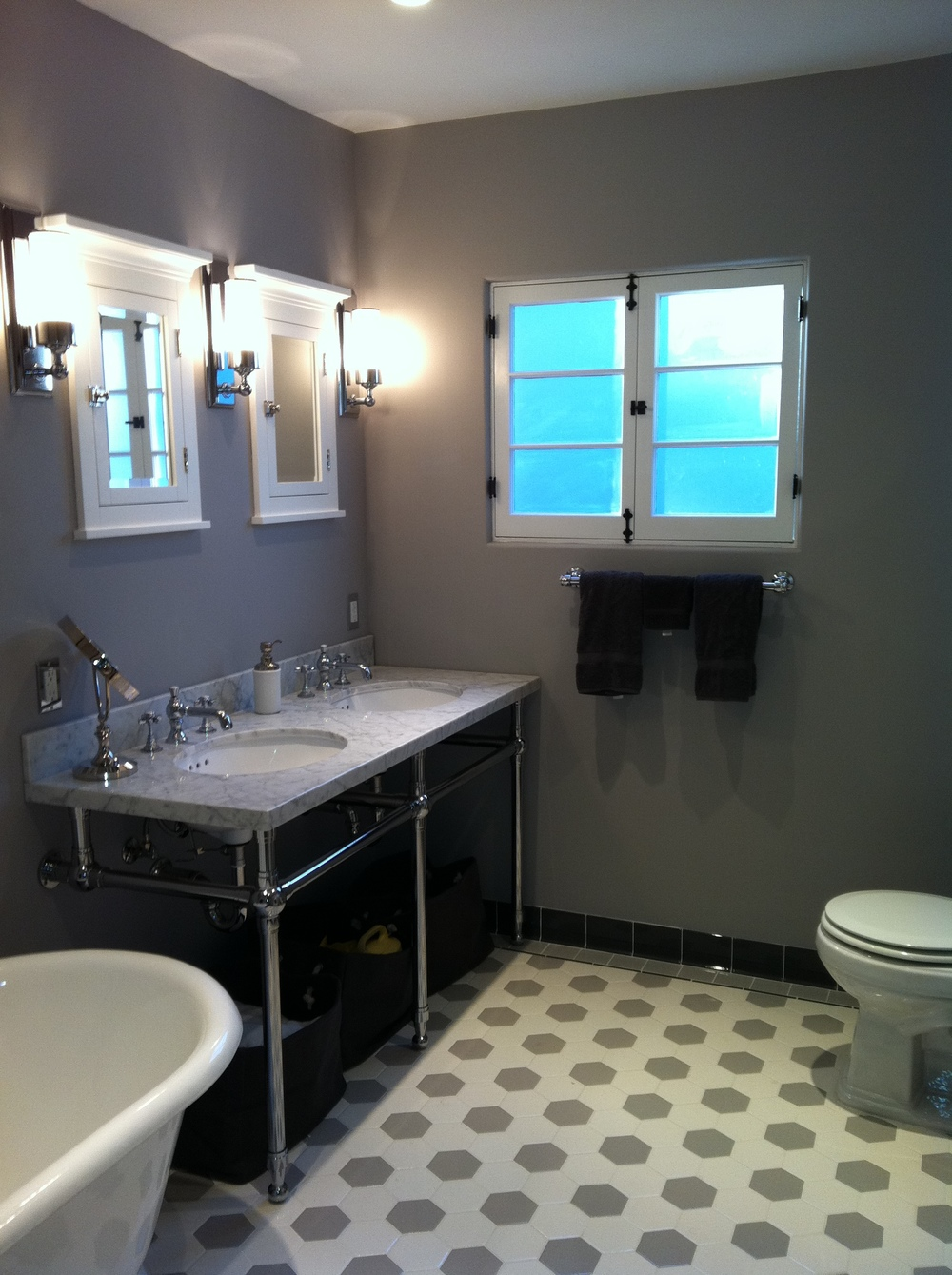 1927 bathroom re-created with period materials and reproduction tile and fixtures.