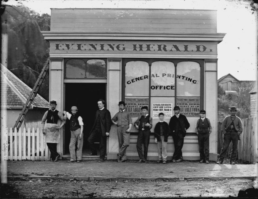 "I like to think that the apprentice in the middle is a young Thomas Driver casually practising shuffling cards in one hand.    ""  Group outside the Evening Herald office in Wanganui. Harding, William James, 1826-1899 : Negatives of Wanganui district. Ref: 1/1-000139-G. Alexander Turnbull Library, Wellington, New Zealand.   http://natlib.govt.nz/records/22883849  """
