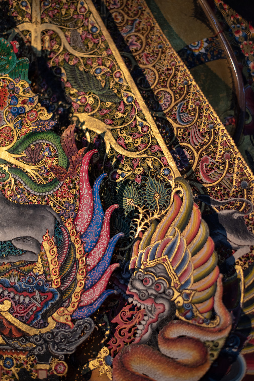 Ornate hand-painted shadow puppets known as Gunungan