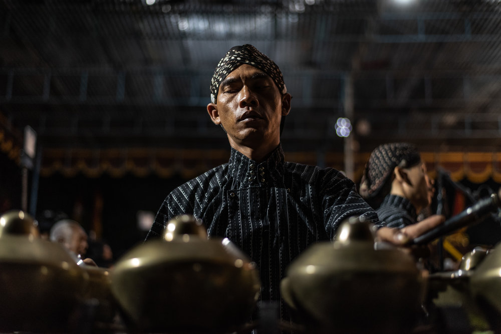 Gamelan player focuses