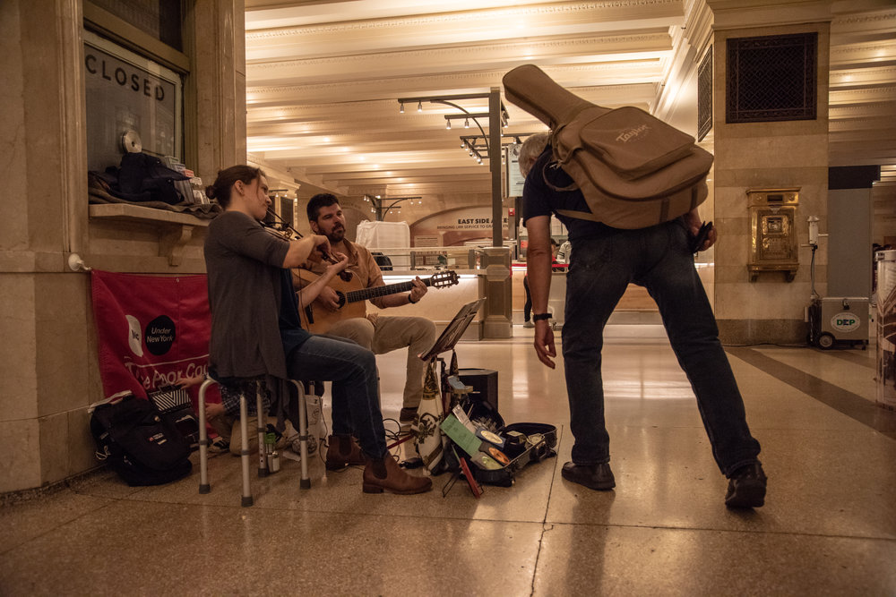 Busking means they are only paid what they earn from tips and CD sales.