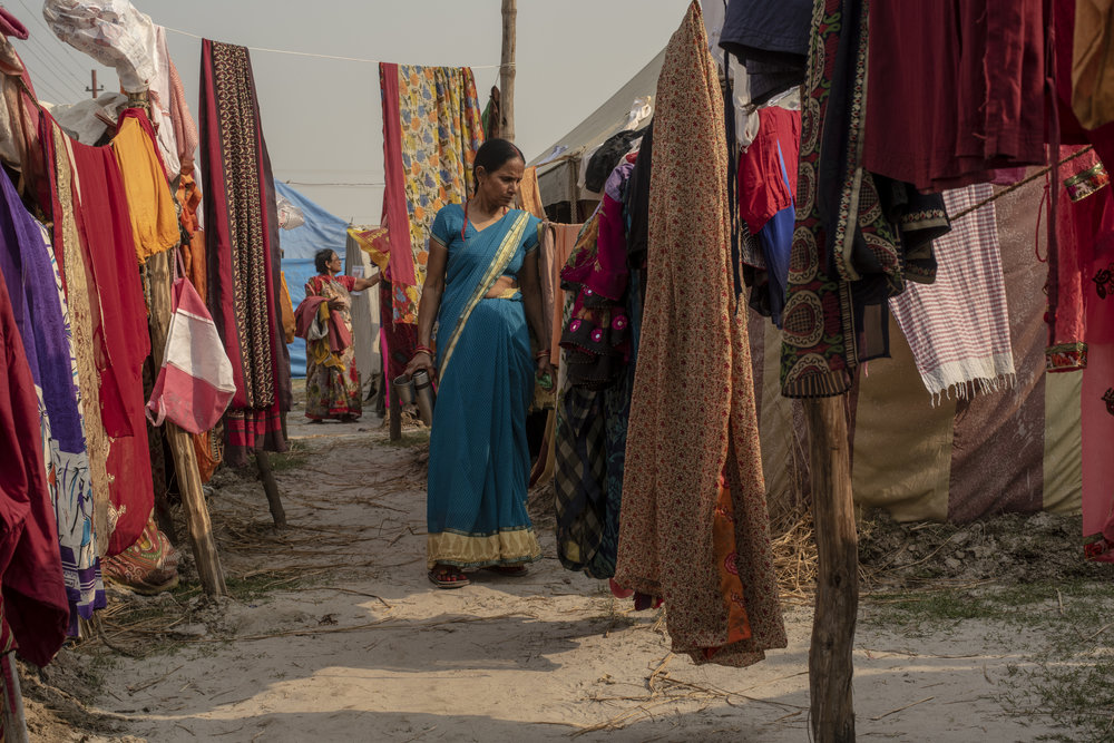 Women hang sarees out to dry