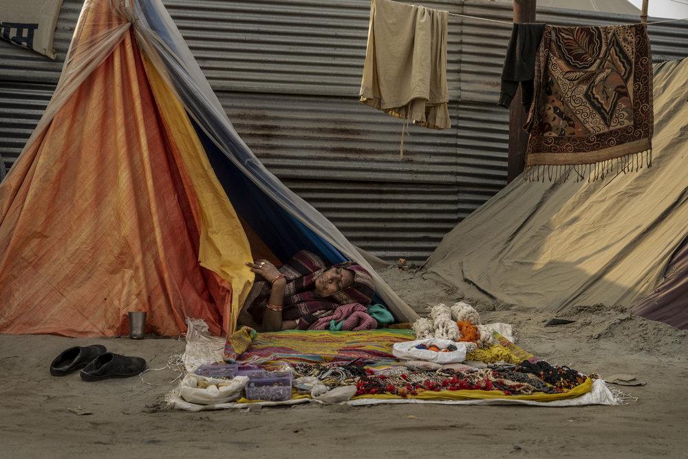 Women sleeps in here roadside tent as she sells wares.