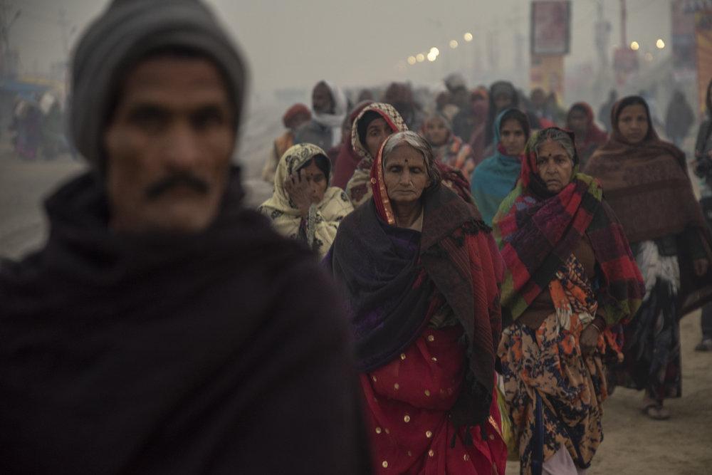 Group of women led through the Mela.