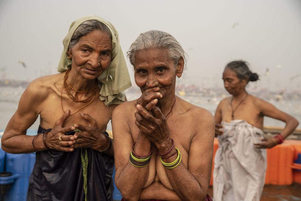 Elder women bathe in the Ganges