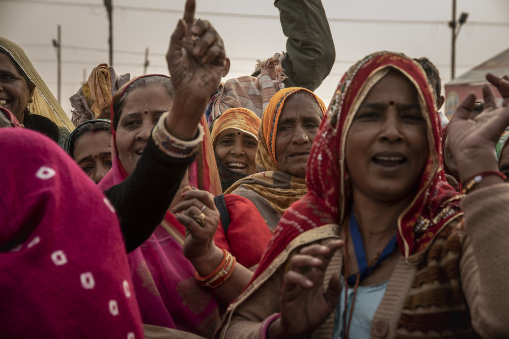 A group of women sing as they walk towards Sangam, the confluence of the holy rivers.
