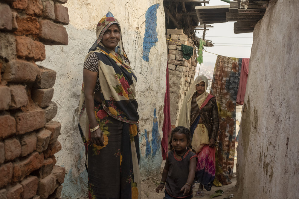 Vimla, age 60, has lived on the outskirts of the mela with her children and grand children for 3 generations.