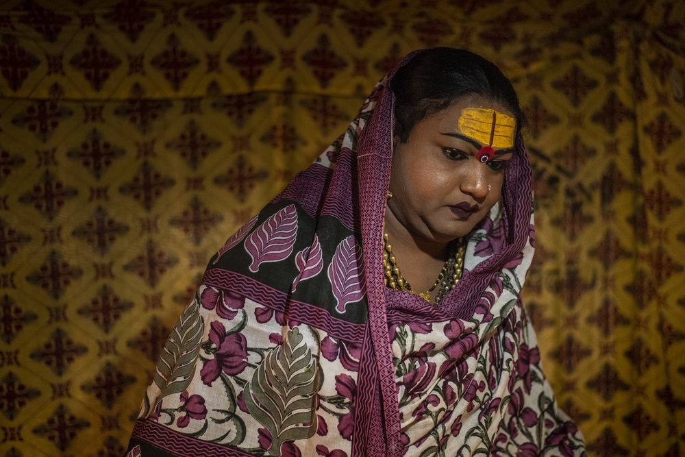 Mayuri Ma, a kinnar akada (transgender), prepares to leave her tent to give blessings to her followers.
