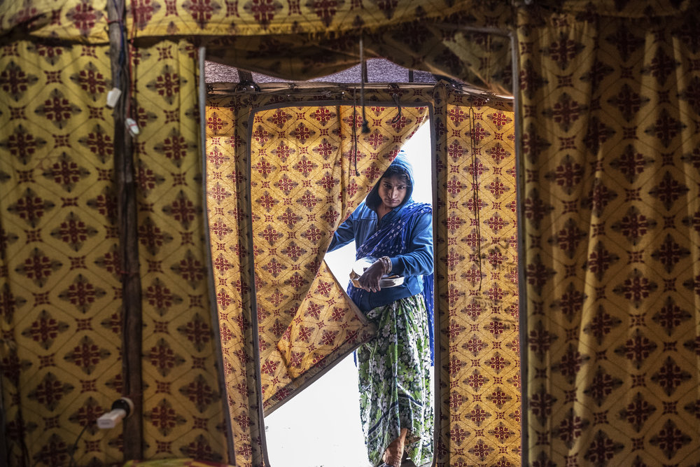 A Kinnar Akada (transgender) enters living quarters