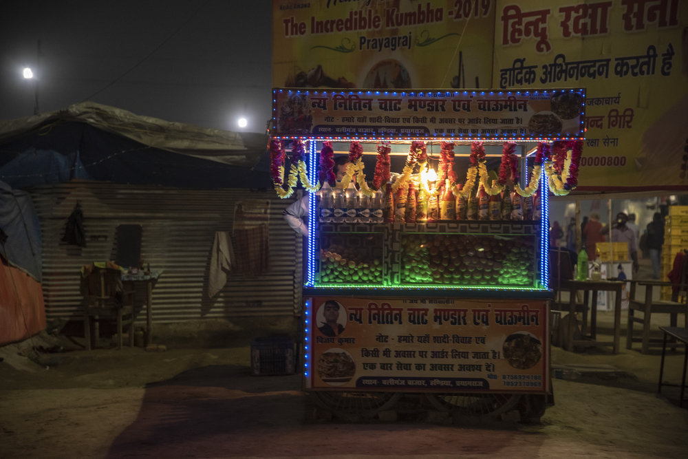 Illuminated roadside food stall