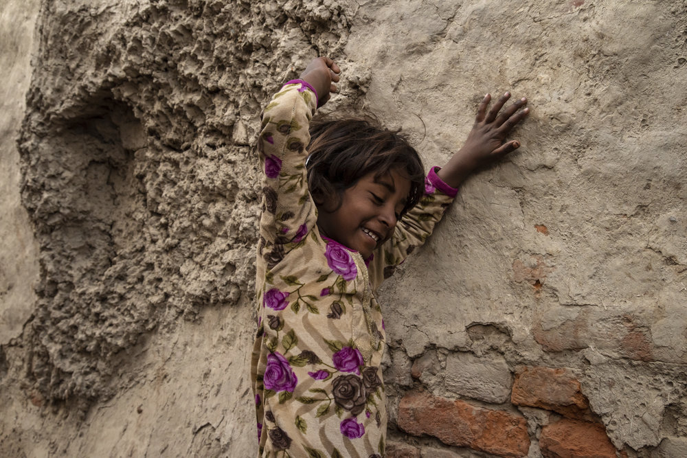 Young girl who lives on the outskirt of the mela