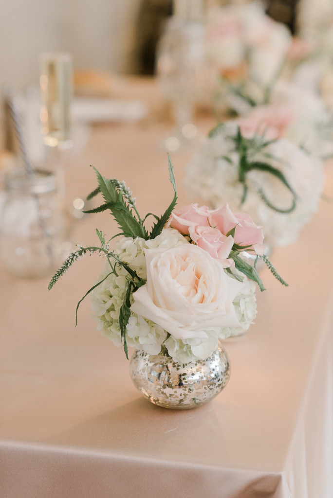 We fully embraced this dream-like blush theme, using our silver mercury bud vasesto decorate the sweetheart table.