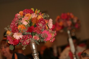 Lush pink elevated centerpieces on silver flower tower.