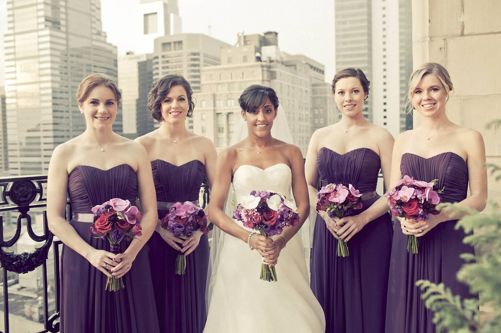 Philadelphia wedding florist lauren jonathan at the hyatt at the bridesmaids wore beautiful plum gowns which coordinated perfectly with their bouquets of purple lisianthus light purple stock scabiosa ombrellifo Image collections