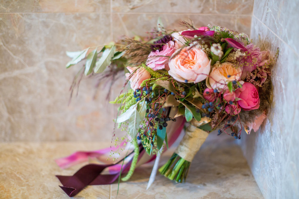 My bouquet was unlike any I had ever seen before. It had a wild mix of elements - garden roses, berries, astilbe, dahlias, greenery, amaranthus - and the perfect cascading shape that I love, without being too overwhelming. Ribbon tails enhanced the cascade, and man, I loved my bouquet.