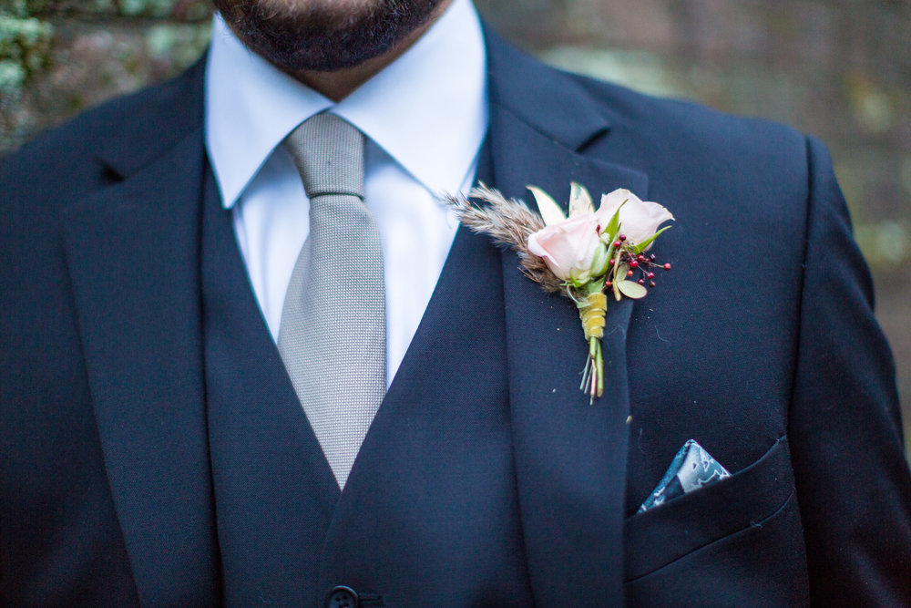 Kevin's groom bout was very seasonal, with light pink spray roses, berries and a touch of greenery.