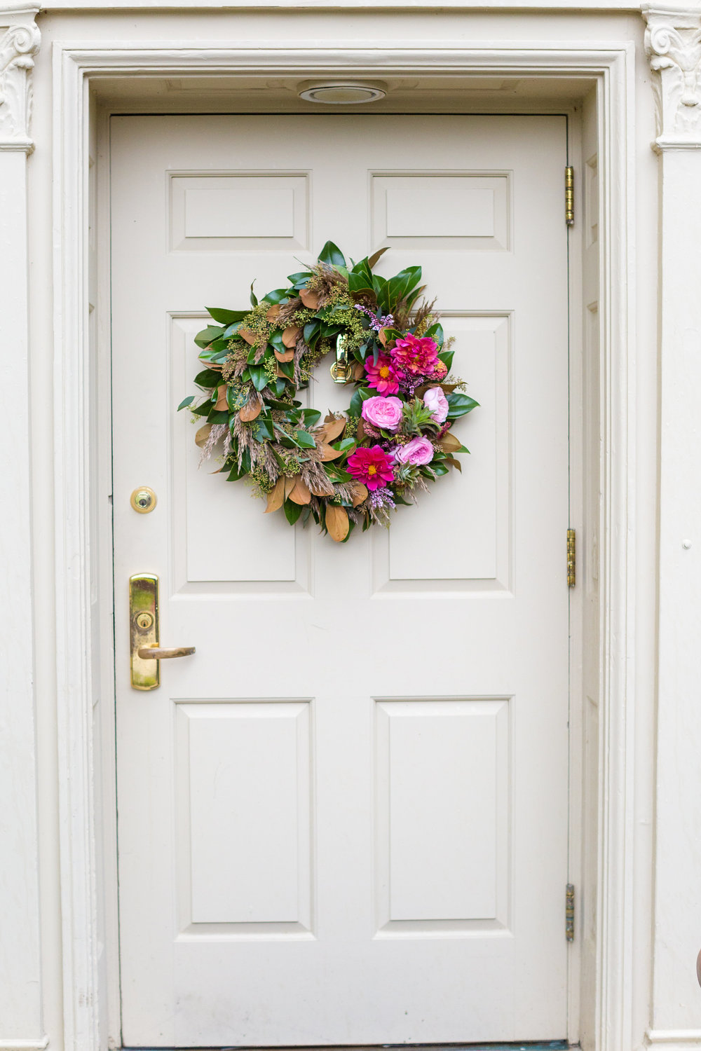 Guests were greeted with a welcome that was in true A Garden Party fashion.  I love this wreath of magnolia leaves, eucalyptus, peach garden roses and dahlias.