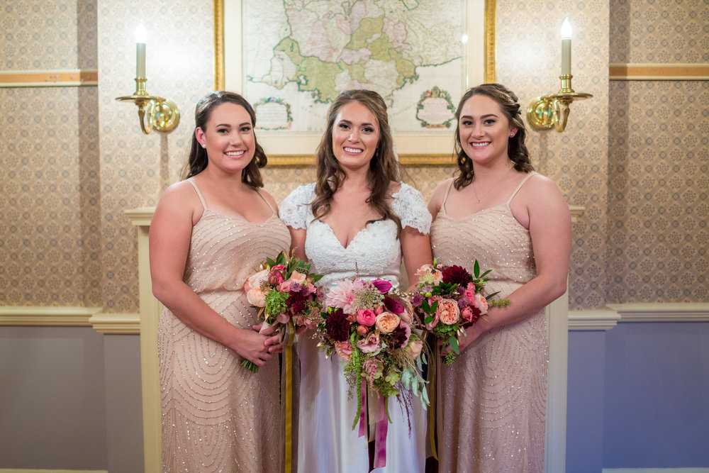 My two sisters were my bridesmaids, carrying smaller versions of my bouquet.  I loved how familial my entire wedding experience was, and there are no two women closer to my heart than these two!