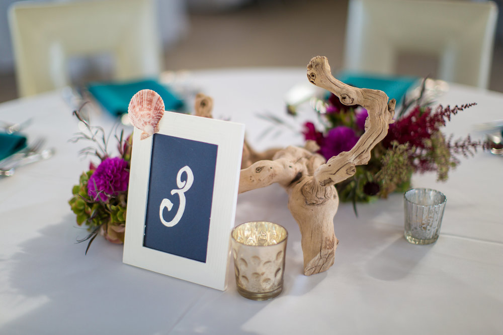 Our driftwood pieces were accented with silver mercury votives and small floral arrangements of hydrangeas, dahlias and astilbe for another centerpiece design.