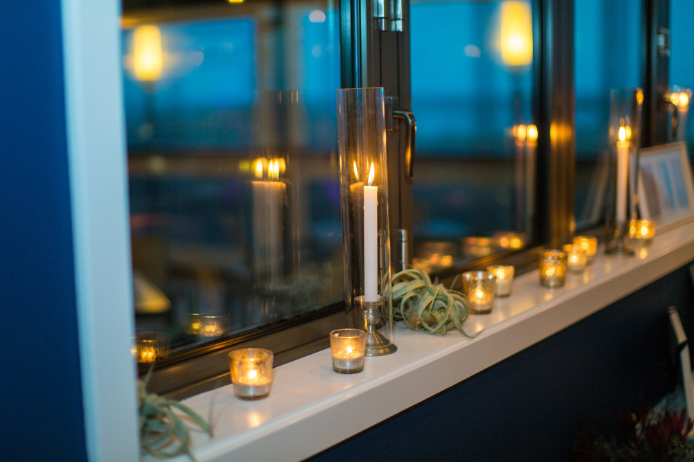 The Windrift has a ton of windows to create its sense of openness in the room, and to give a great view of the beach outside - but when night comes, nothing feels more romantic than tons of candlelight reflecting off the windows for double the glow!