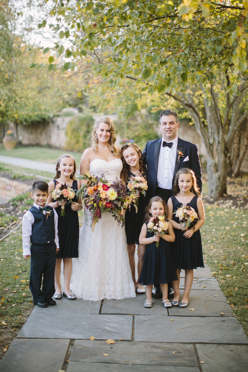"Todd's children made up the bridal party for the couple's wedding. The girls carried small bouquets of roses, spray roses, seeded eucalyptus and """".   All bridal parties have sentimental value, but this gesture seemed particularly sweet, and we are so happy for this family!"