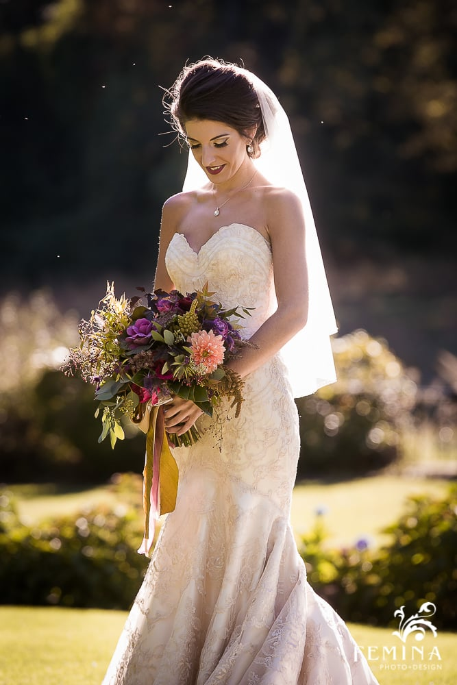 Amanda wanted natural shape in her bouquet, and we complied with a mix of dahlias, celosia, callicarpa, purple kale, roses and ranunculus. She added her own touches with lace from Italy and a fleur di lis charm.