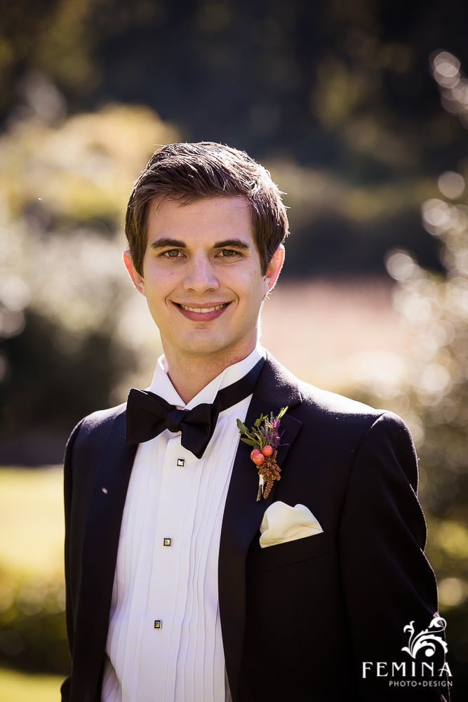 The handsome groom, Harry, wore a seasonal bout of purple and greens, with some berries and rosemary.