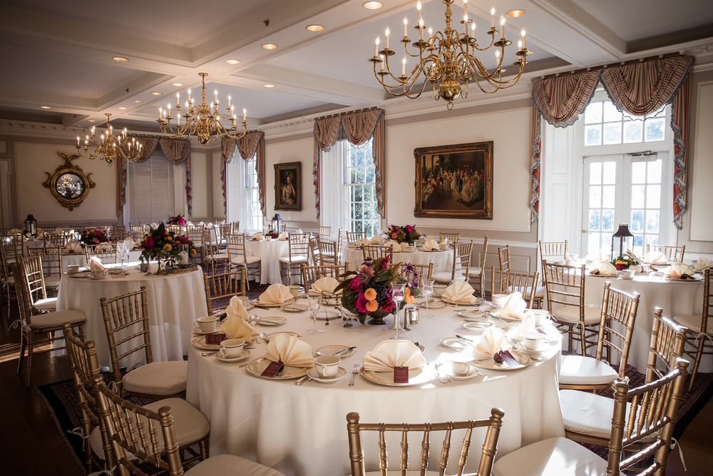 Brantwyn is a historical manor, so there are many different rooms for dining during events.   We used two different types of low centerpieces to break up the space, but kept with Amanda's wishes for bright colors and a fall theme.