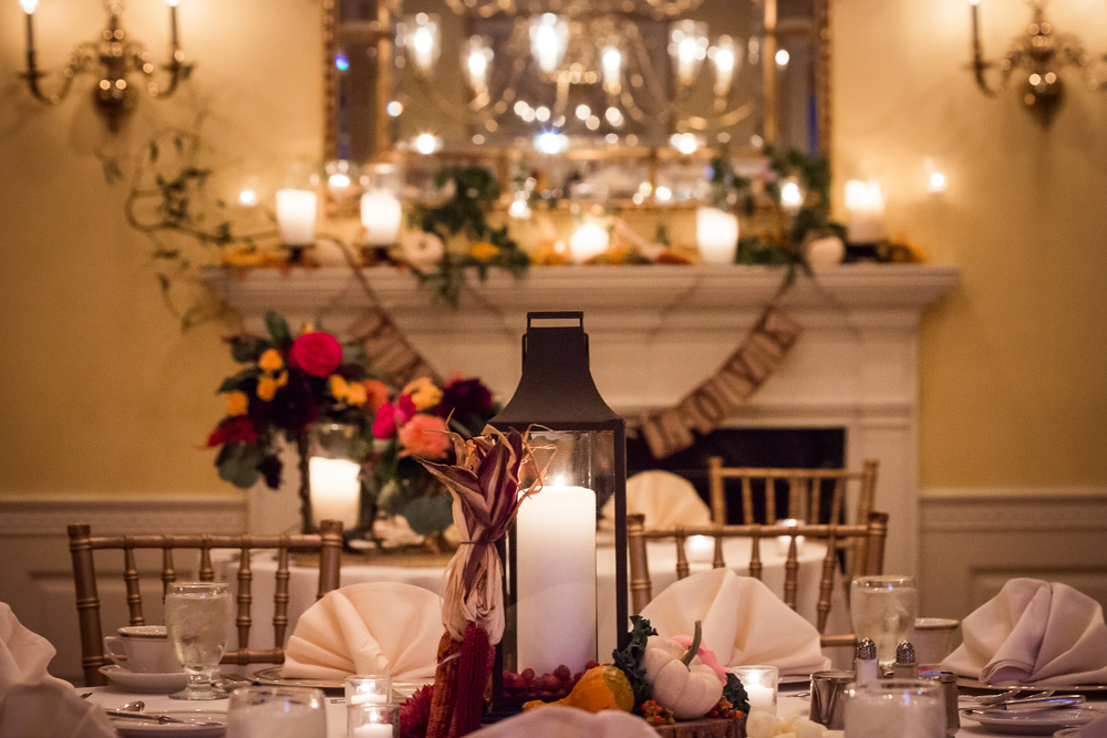 We helped bring some life to this lantern centerpiece by placing it on our wood slices and surrounding it with gourds, berries and some more of that great Indian corn.