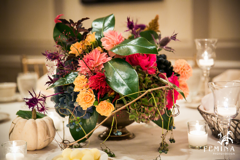 This compote centerpiece was made using purple thistle (!), hydrangea, magnolias leaves, dahlias, roses, berries and greenery.