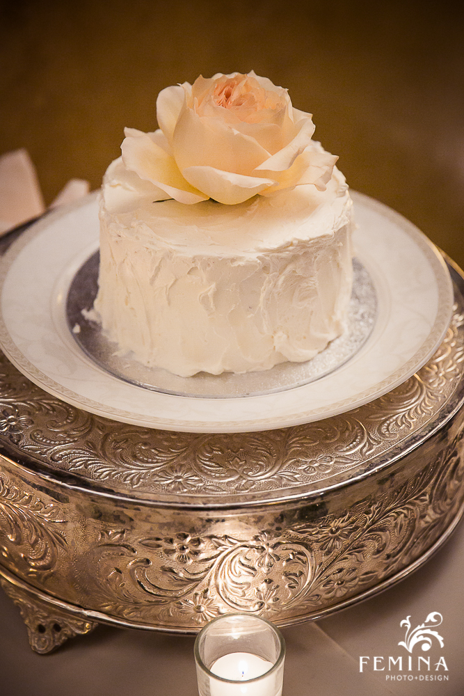 This adorable cake didn't need much decorating, but a single rose served as the perfect topper.