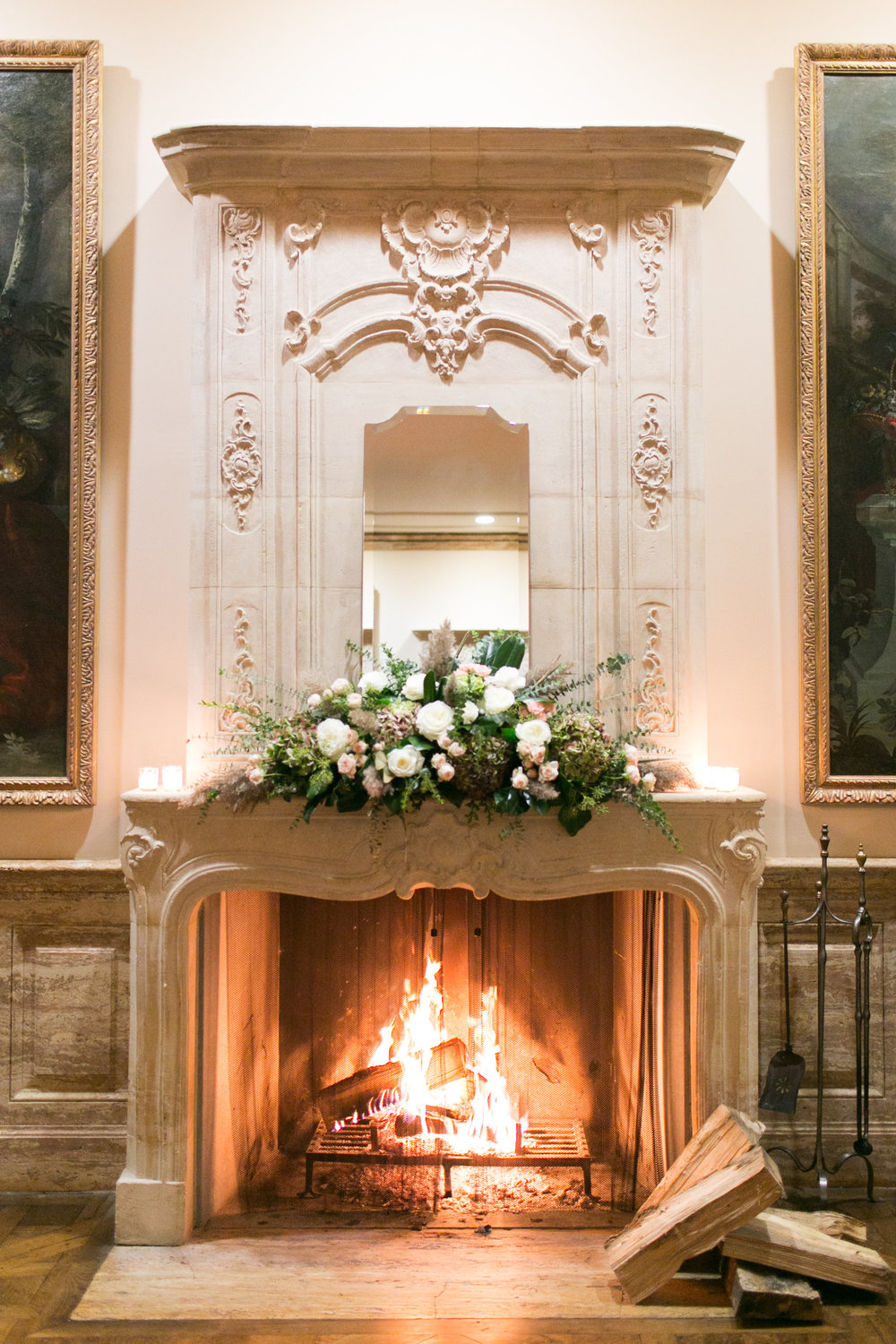 How gorgeous is this fireplace?  We had to create a design that matched the ornate beauty of the mantle.  A huge floral arrangement of roses, hydrangea,