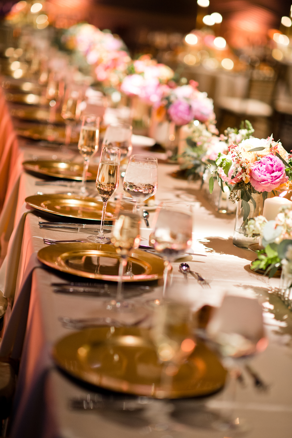 NJ wedding, gold charger, long head table, bridal party table, gold and peach wedding at Camden Aquarium