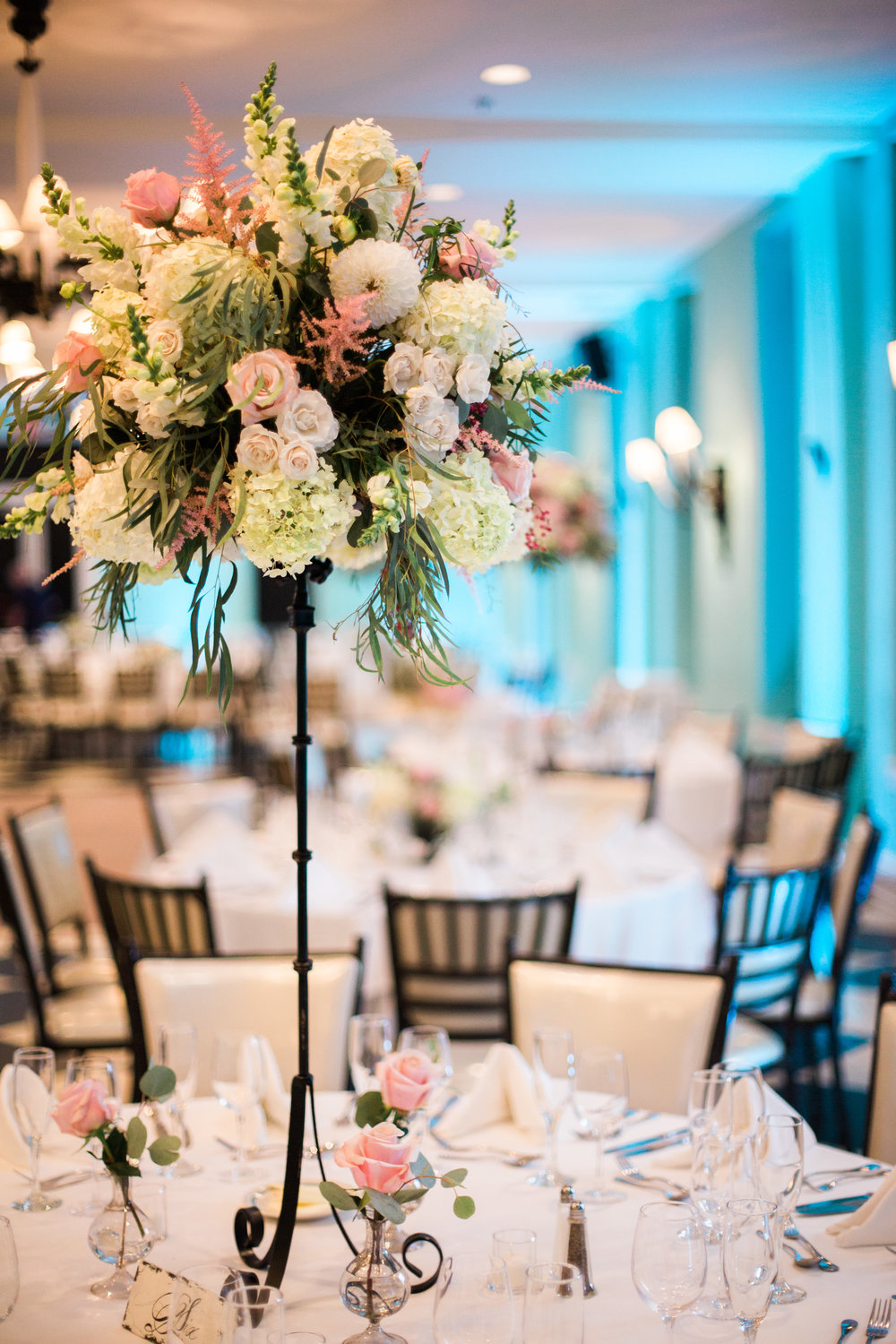 Cape may wedding florist taylor nate at congress hall feat some flair to the room topped with lush arrangements of dahlias roses astilbe hydreangea and greens small bud vases added some balance to the base reviewsmspy