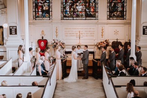 indoor ceremony - church wedding - red and pink flowers